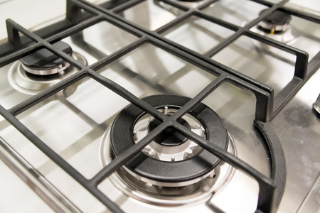 gas burner: The new clean gas burner cooker closeup Stock Photo