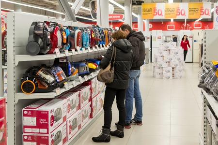 acquirer: Moscow, Russia - February 02. 2016. Customers choose a vacuum cleaner in  Eldorado is large chain stores selling electronics and household appliances