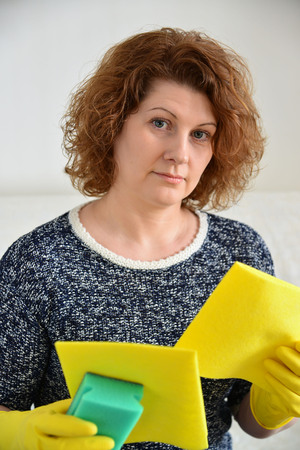 upcoming: Woman thinks about the upcoming cleaning in the house
