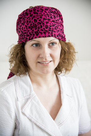 adivino: Portrait of a woman with a scarf on her head like a gypsy Foto de archivo