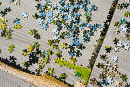 collected: Picture collected from puzzles lies n the floor
