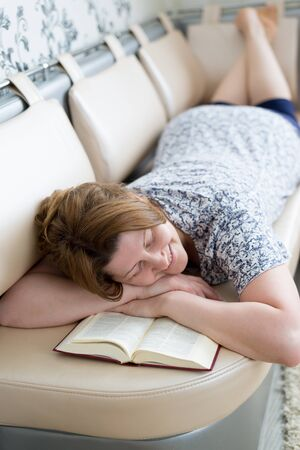 fell: The woman fell asleep while reading a book Stock Photo