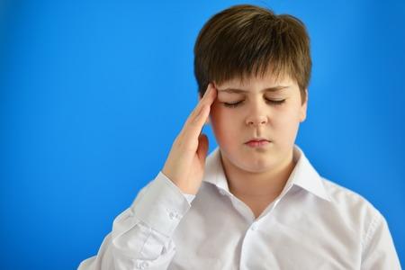 accosting: Portrait of a teenage boy with a headache