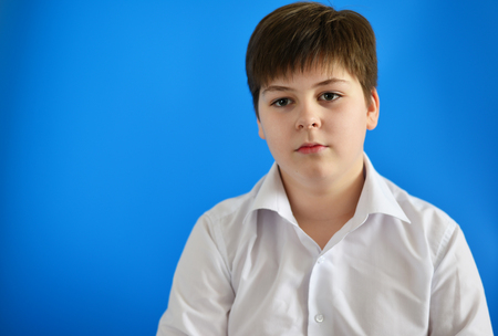 accosting: Portrait of teenage boy on the blue background
