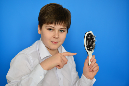 accosting: Boy teenager with a comb in his hand