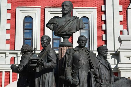 kazansky: Moscow, Russia - March 14, 2016. Monument to a founders of Russian railroad on background of Kazansky station