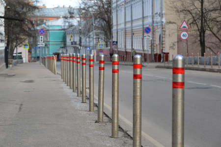constraints: Moscow, Russia. Fence of the columns along the road in the alley Gorokhovskii Stock Photo