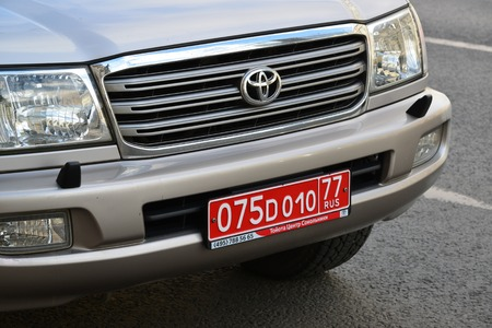 diplomatic: Moscow, Russia - March 14, 2016. Red diplomatic number on a cars Toyota Editorial