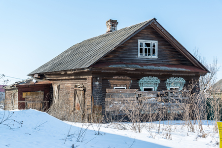 boarded: Abandoned rural wooden house with boarded up windows in Russia Stock Photo
