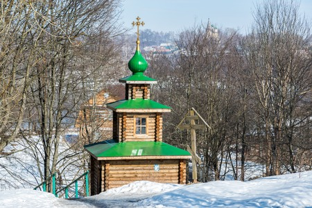 log cabin in snow: Chapel on the source of holy water in the city of Tutaev, Russia