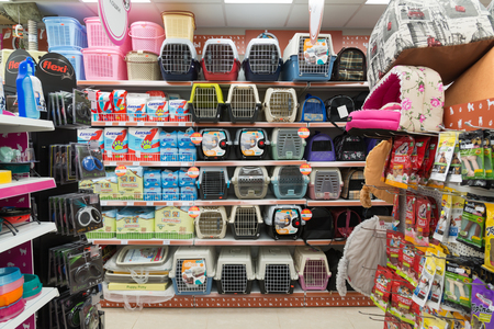 carriers: Moscow, Russia - April 16.2016. Carriers and couches in a Four paws pet store
