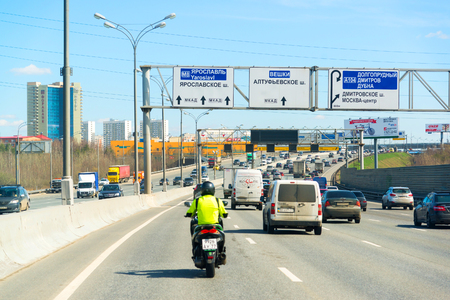motociclista: Moscow, Russia - April 08.2016. Motorcyclist in the left lane on Moscow Ring Road.