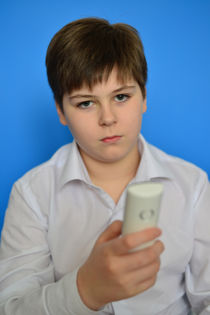 pert: Boy teenager dials the number on the radiotelephone Stock Photo