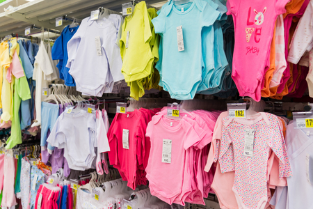 large store: Moscow, Russia-April 24.2016. Clothes for babies in a large store network Auchan