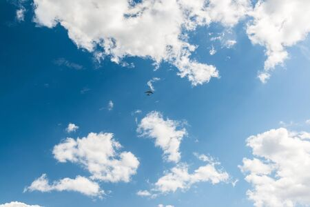 small plane: Blue sky with clouds on summer day with a small plane Stock Photo