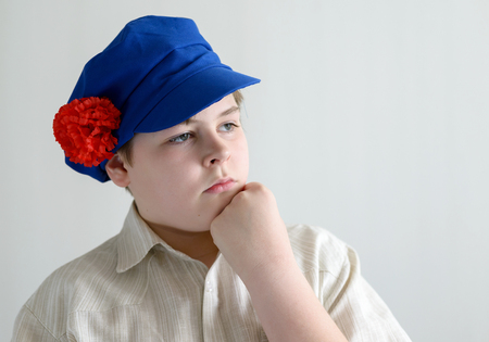 teeny: Portrait of a boy teenager in Russian national cap with cloves