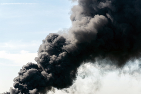 black smoke: A lot of black smoke from the fire