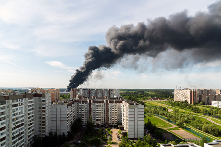 housing lot: Black smoke from a major fire in a Moscow, Russia