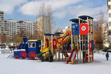 multistory: Moscow, Moscow - February 20.2016. Playground structure in the courtyard of a multistory apartment building