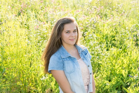 teeny: 15 year old girl with long brown hair on the summer glade Stock Photo