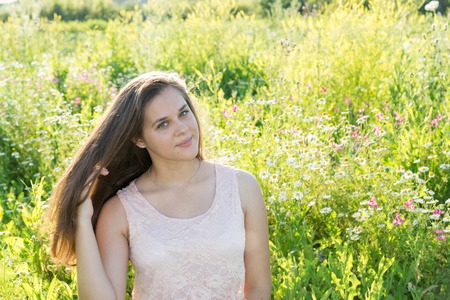 15 year old girl with long brown hair on the summer glade Stock Photo