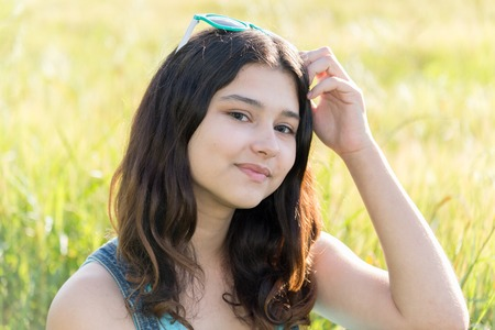 teeny: Portrait of a teen girl outdoors in summer