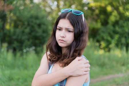 teeny: teen girl with health problems in the nature in summer