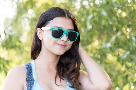 teeny: Portrait of teen girl in sunglasses on a nature summer