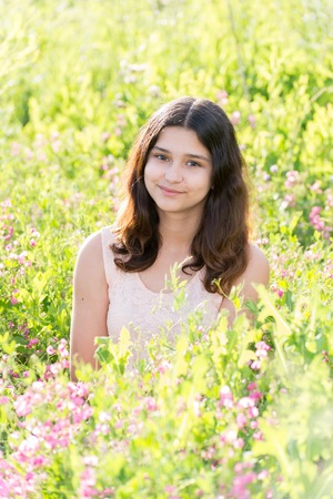 teeny: Girl teenager on a beautiful meadow