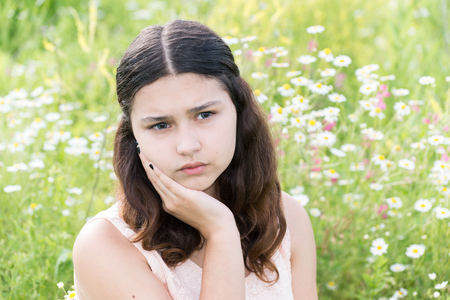 melancholy: Teen girl thinks about the problems of the outside Stock Photo