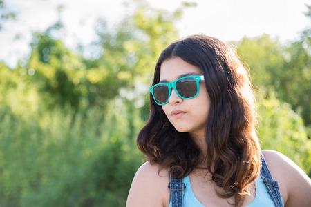 teeny: Portrait of a beautiful teen girl in sunglasses Stock Photo