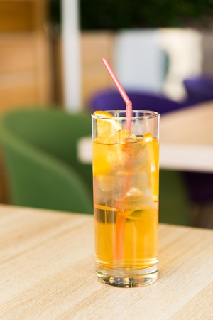 A glass of lemonade on a table in a cafe