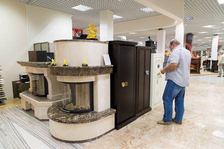chooses: Khimki, Russia - September 03.2016. The buyer chooses metal safes in the largest furniture store Grand