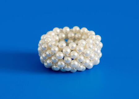 scrunchy: Scrunchy with pearl on a blue background