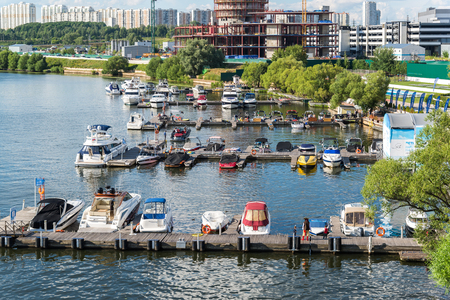 Moscow, Russia - July 09.2016. Pleasure boats at the pier of the yacht club Shore House Editorial