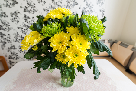 wonderfull: Bouquet of yellow and green chrysanthemums standing on the kitchen table