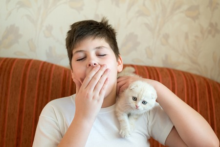 lop eared: The boy is allergic to a cat