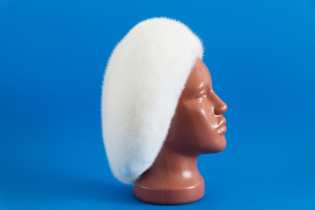 mink: White beret from natural mink on a mannequin