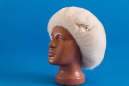 mink: pearly beret from natural mink on a mannequin