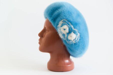 mink: light blue beret from natural mink on a mannequin.