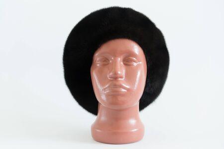 mink: black beret from natural mink on a mannequin
