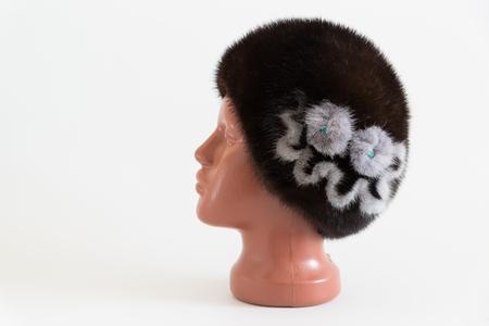 visone: brown beret from natural mink on a mannequin
