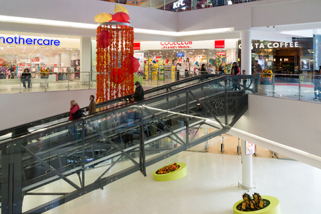 entertainment center: Moscow, Russia - October 01.2016. People on the escalator in the shopping and entertainment center Gagarin