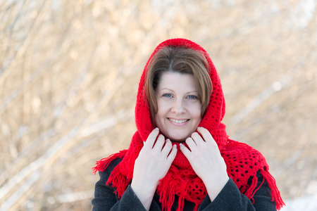 Russian woman with a red knitted shawl on her head