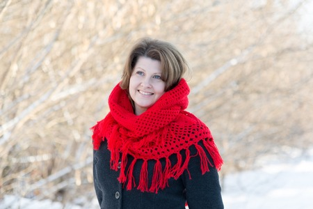 Russian woman with a red knitted shawl on his shoulders
