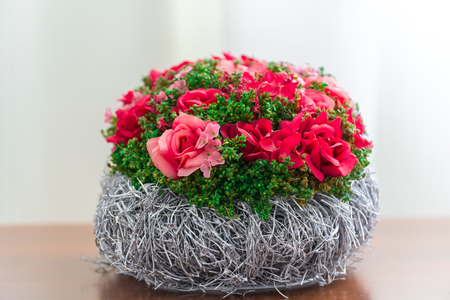 Composition of artificial flowers in the interior Stock Photo