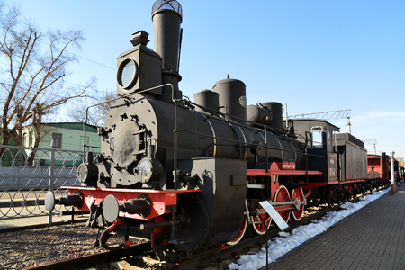 amplified: Moscow, Russia - April 1.2017. Black old locomotive in Museum of History of a Railway Transport Development Editorial