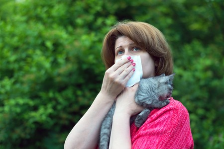 A woman with allergies to a cat Stock Photo