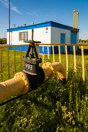Gas pipeline against background of the gas distribution station in the village. Russia
