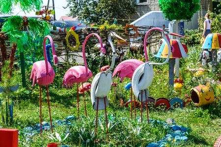 Flamingos are made of car tires on a playground, Russia